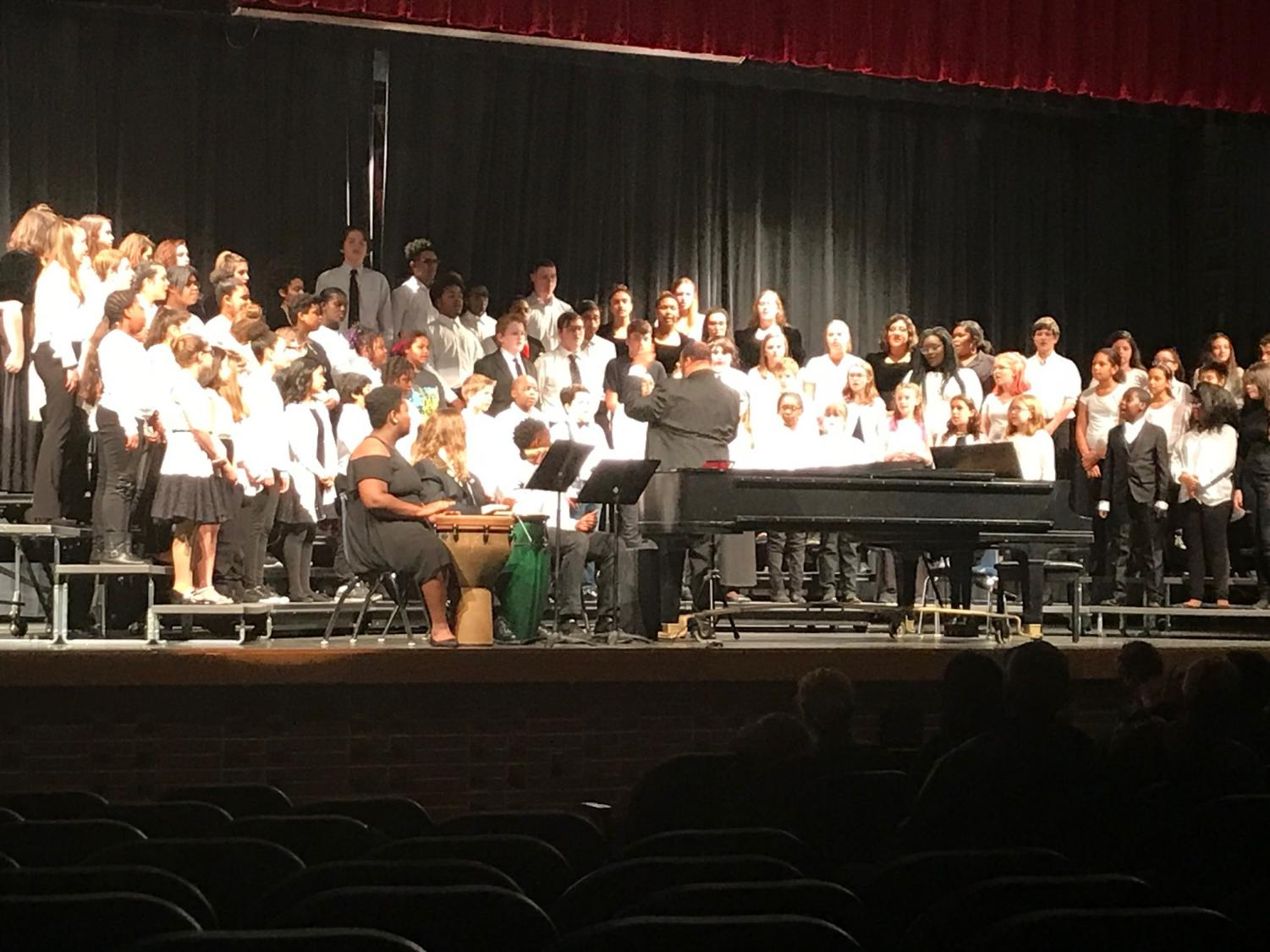 Mr. Pinder conducts the combined voices of current and past students during the Spring Alumni Concert in March 2019.