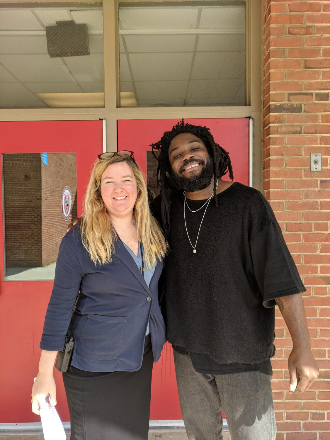 Author Jason Reynolds and Ms. Sporre, Media Specialist at GBHS